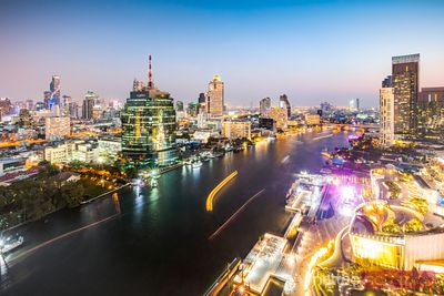River and skyline at dusk, Bangkok, Thailand