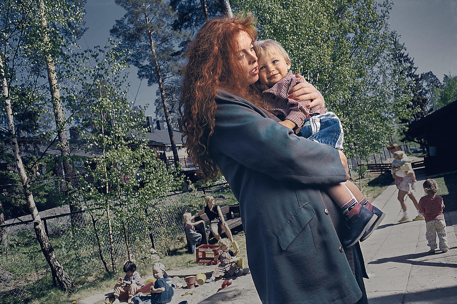 02-intimate-portrait-of-mother-reunited-and-carrying-her-child-to-safety