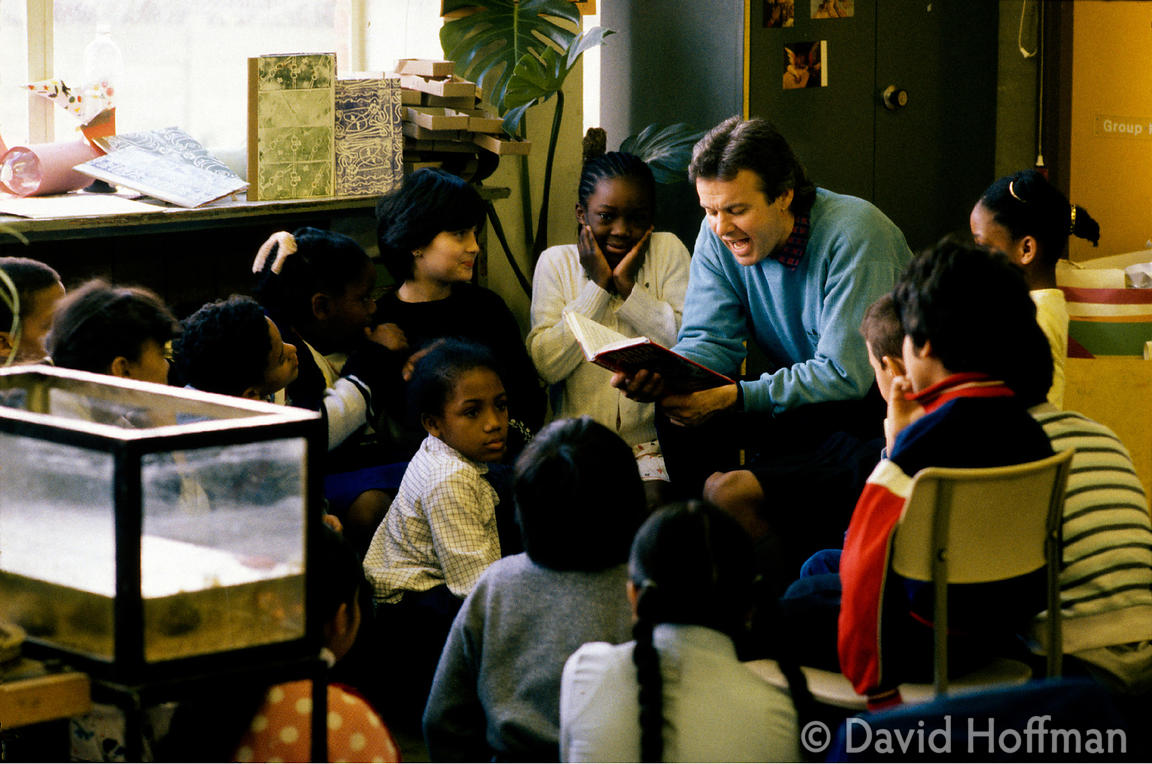 Reading To Class 3 Teacher reading to children at Newfields Primary School, Brent.