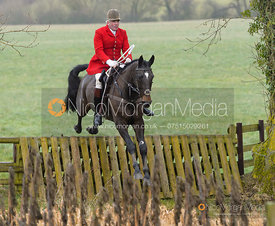 Andrew Osborne jumping a hunt jump at Peakes - The Fitzwilliam Hunt visit the Cottesmore at Burrough House