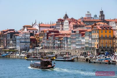 Boat passing in front of Ribeira district, Porto, Portugal
