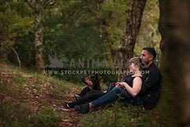 pregnant couple with dog