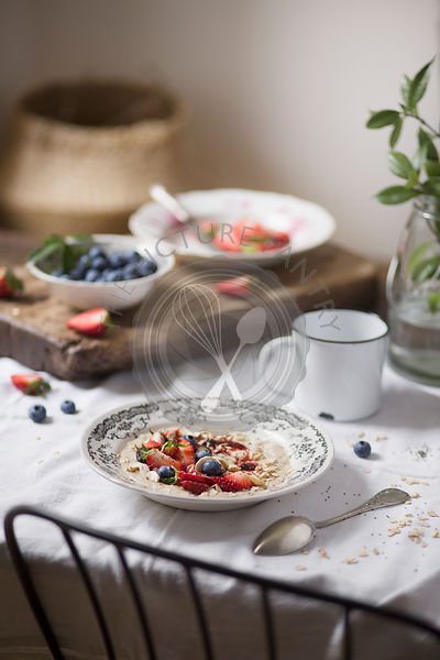 Porridge with fresh fruit on breakfast table