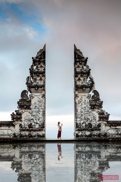 Balinese woman praying at Lempuyang temple gate, Bali