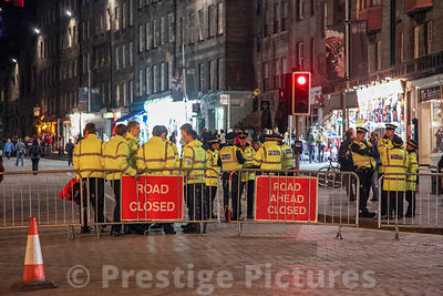 Police and Private Sercurity Guards in Road at Night