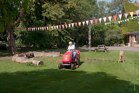 #73080,  Cutting the grass, Summerhill School, Leiston, Suffolk. The school was founded by A.S.Neill in 1921 and is run on de...