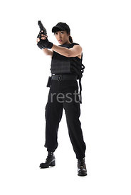 A tough woman, pointing a gun – shot from low level.