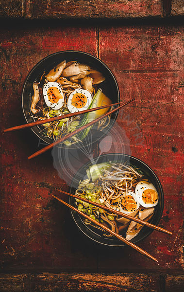 Japanese Ramen bowls with chicken meat and shiitake mushrooms
