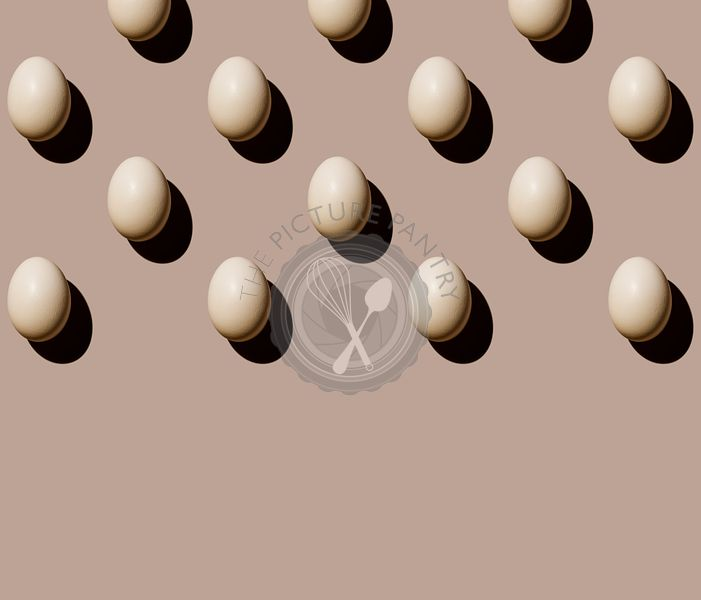 Chicken eggs on beige background Pattern