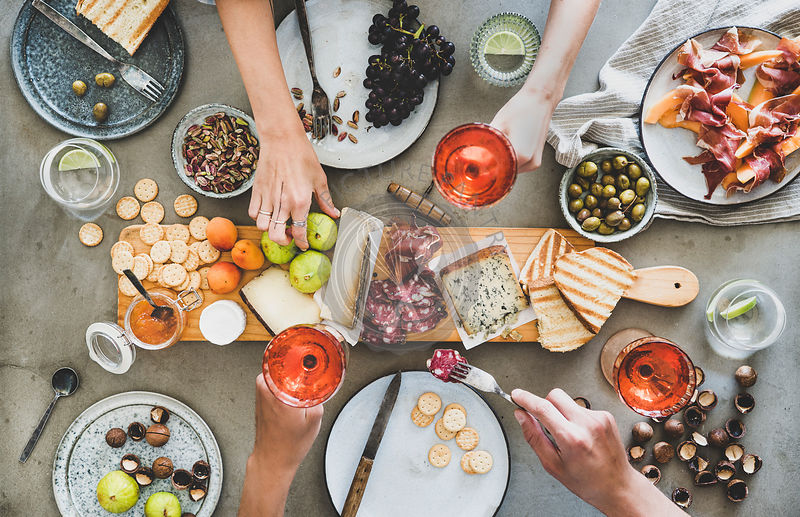 Mid-summer seasonal picnic with rose wine, cheese, charcuterie and appetizers