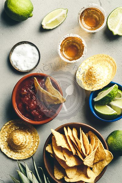 Mexican food and tequila shots, flat lay