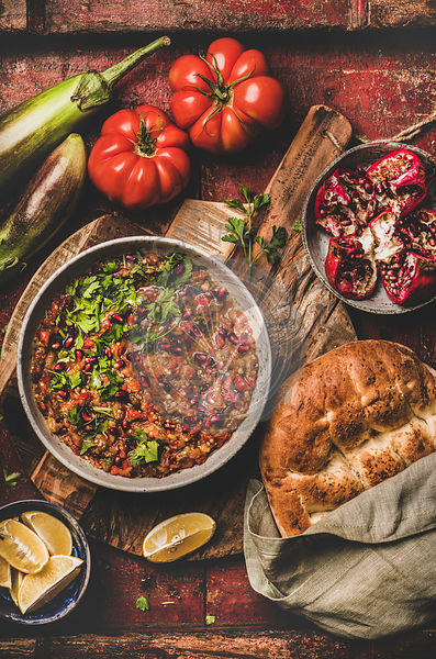 Babaganoush cold dip seasoned with fresh parsley and pomegranate seeds