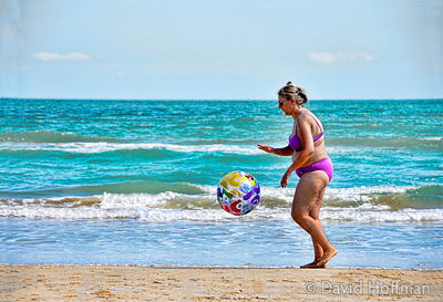 070911-21_Majella_007-tpz Middle aged woman exercising with a beach ball at Pineto beach, Italy.