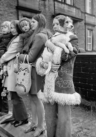 #77131,  Watching the 'Nutters' Dance', Bacup, Lancashire,  1973.  On Easter Saturday every year the 'Coconut Dancers' gather...