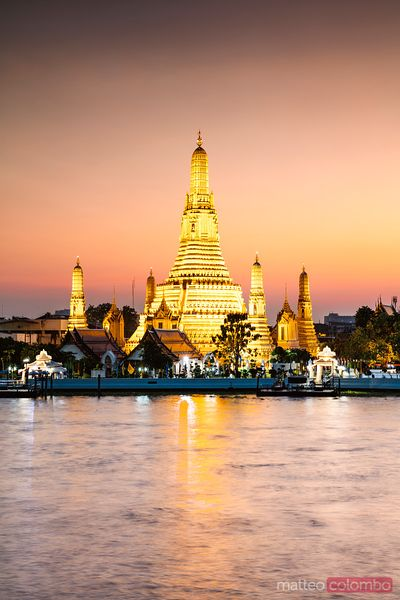 Wat Arun illuminated at dusk, Bangkok