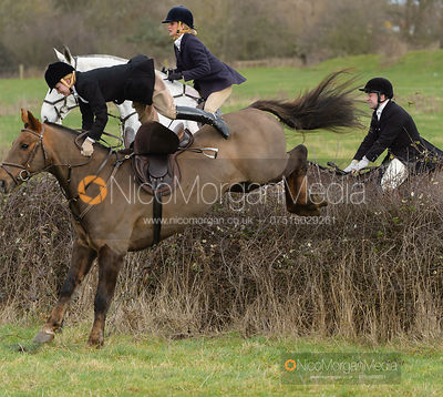 Flip Redman jumping a hedge from the meet at Sheepwash