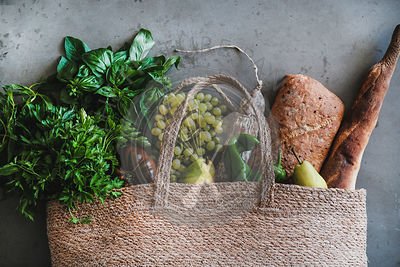 Flat-lay of healthy shopping bag with fresh vegetables and fruits