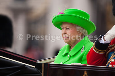 The Queen riding in an Open Carriage on her official 90th Birthday in London