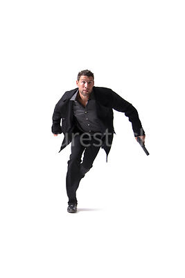 A semi-silhouette of a smartly dressed man running – shot from mid level.