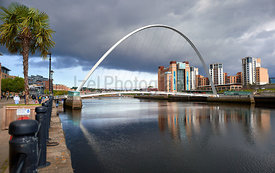 NEWCASTLE UPON TYNE, ENGLAND, UK - SEPTEMBER 09, 2019: The Gateshead Millennium Bridge over the River Tyne and Baltic Art Mus...