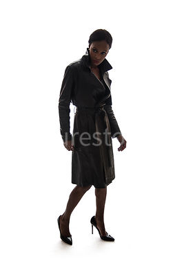 A semi-silhouette of a tough woman, in a leather coat – shot from eye level.