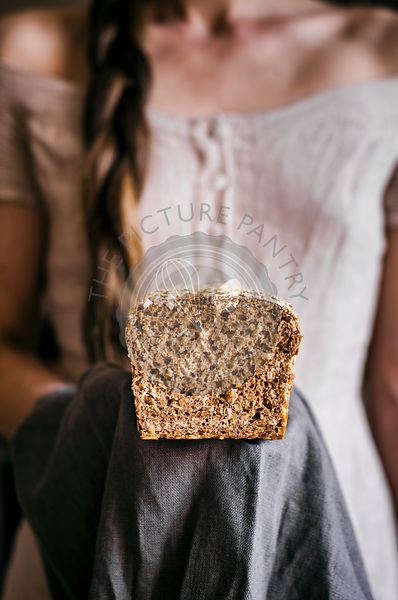 Woman Holding Honey Oat Bread