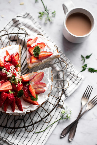Almond Cake Frosted With Coconut Yoghurt, Fresh Strawberries And Mint
