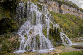 Waterfall of Tufs in the Jura close to the mountain French village of Baume-Les-Messieurs , Franche Comte, France