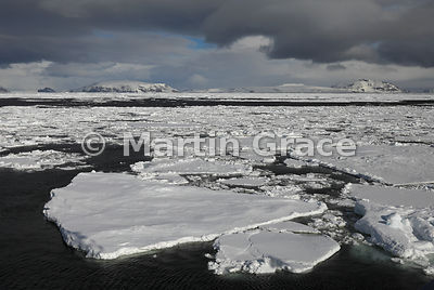 Weddell Sea landscape of ice, land, sea and cloudy sky, Weddell Sea, from Latitude: S63°46.555', Longitude: W57°10.631'; Anta...