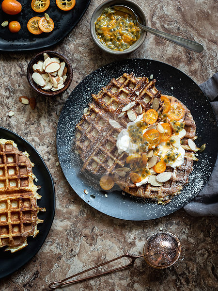 Buttermilk waffles with yogurt, passion fruit and kumquat