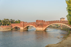 Adige River and fortified bridge Verona Castel Vecchio Bridge or Ponte Scaligero. Verona, Italy.