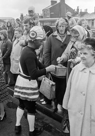 #77129,  The 'Nutters' Dance', Bacup, Lancashire,  1973.  On Easter Saturday every year the 'Coconut Dancers' gather at one b...