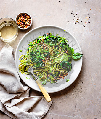 Creamy pea pasta with spicy pine nuts.