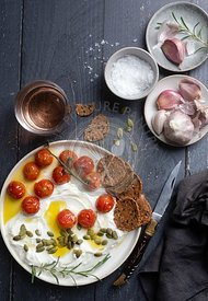 Whipped feta with roasted tomatoes