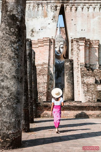 Female tourist at Wat Si Chum, Sukhothai, Thailand