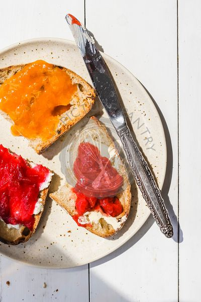 Slices of toast with jam and butter