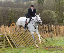Shaun Cripps jumping a hunt jump at Peakes - The Fitzwilliam Hunt visit the Cottesmore at Burrough House