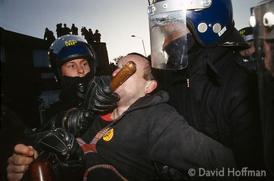 Police attack an anti racist protester in rioting in Welling