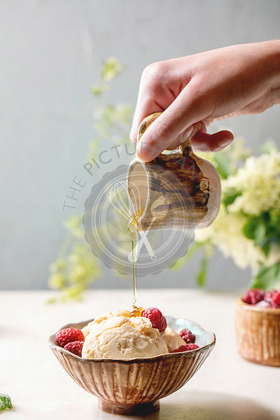 Caramel ice cream with raspberries