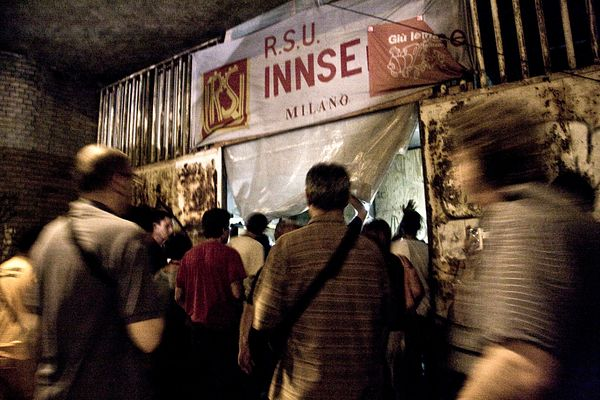 INNSE workers and their supporters re-enter the old factory guard shelter next to the factory. The guard shelter had been occ...