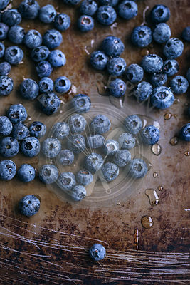 Fresh blueberries on a rustic metal surface