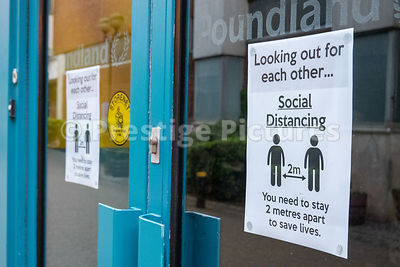 Poundland store with social distancing notices on the doors