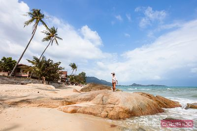 Asian woman standing on rock, Lamai beach, Ko Samui, Thailand
