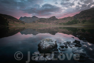 Blea tarn and Langdale pikes catching the first morning light.