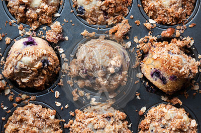 Freshly baked homemade mixed berry oat muffins.