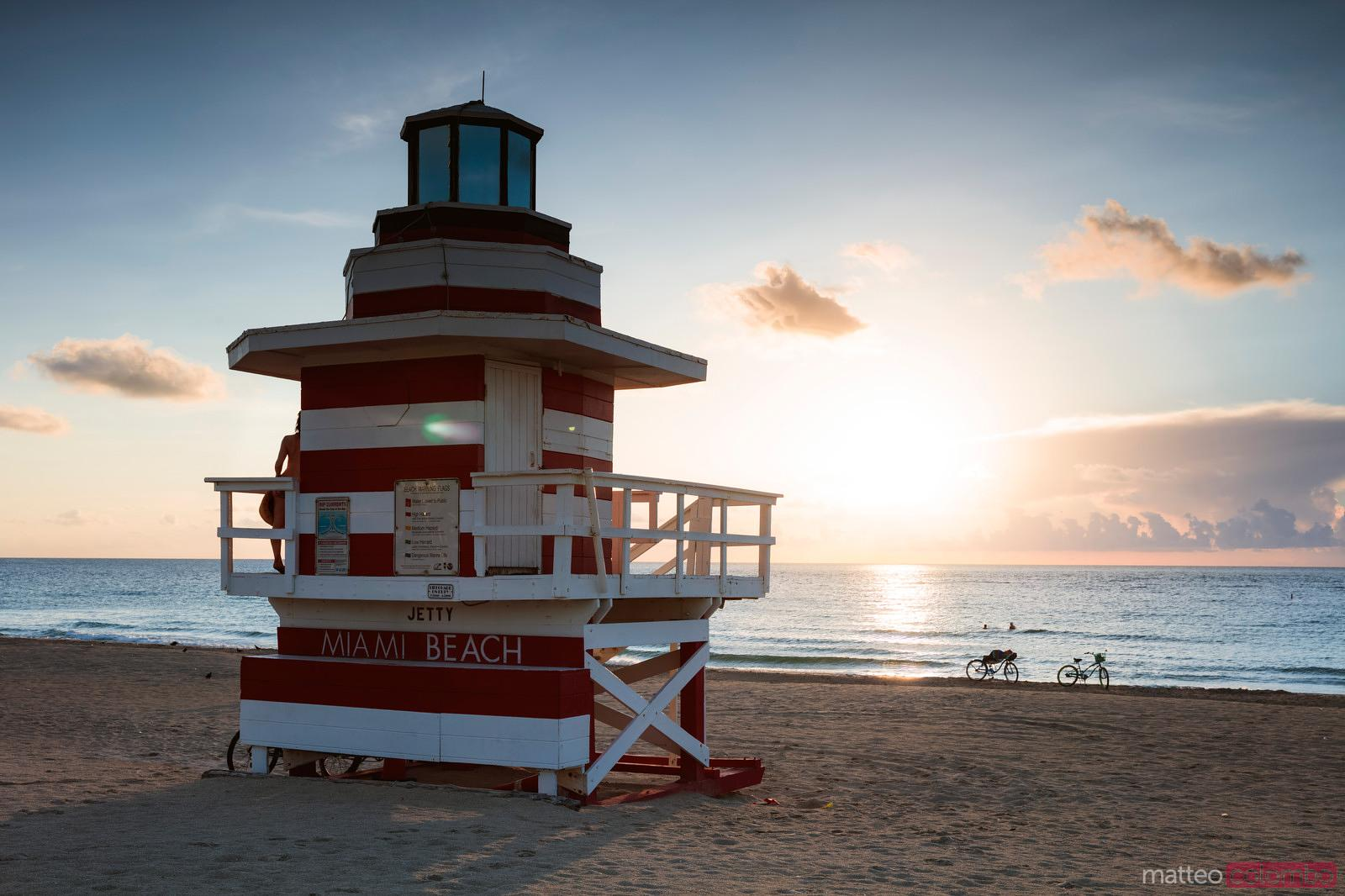 Sun rising in front of lifeguard hut, Miami beach, Florida