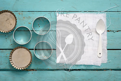 Background fabric, cookie cutter, tart tin.