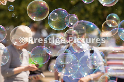Huge Soap Bubbles floating over tourists in Berlin