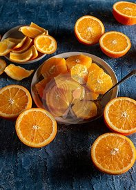 Orange slices plated on a blue background