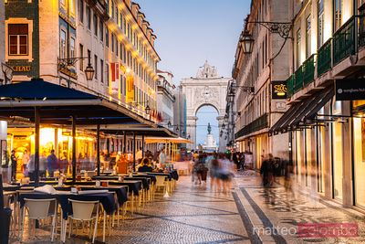 Tourists in the city center of Lisbon at night, Portugal